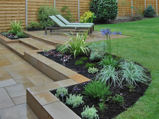 Sawn sandstone paving with bullnose steps