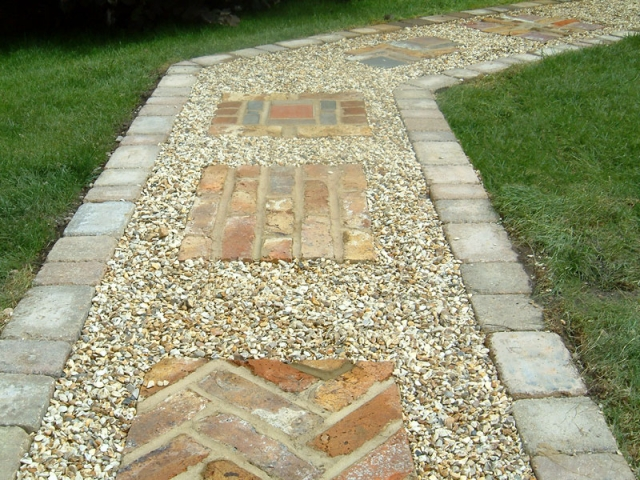 Gravel path with brick inset features