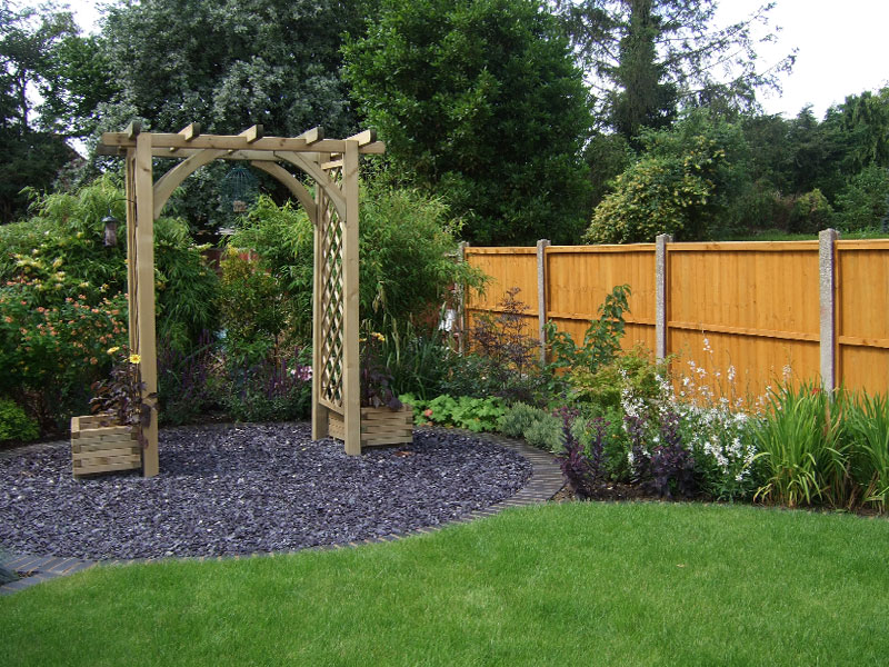 Pergola arch in a slate chipping circle