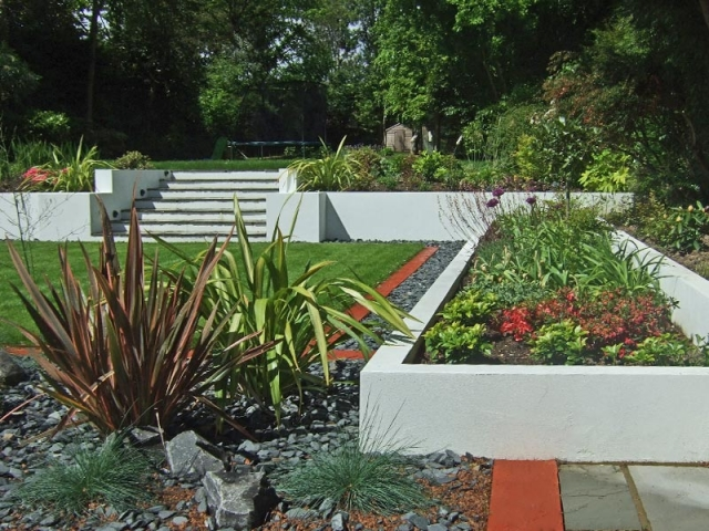 White rendered planters with steps to upper level