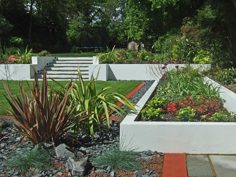White rendered planters with steps to upper leve