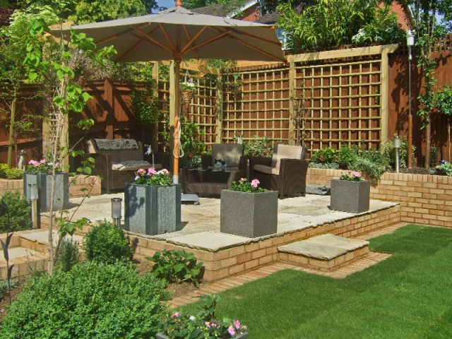 Raised sandstone paving with sun shade
