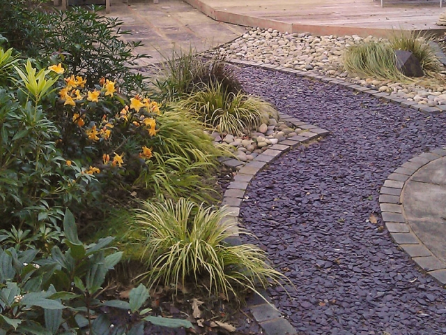 Path with plum slate chippings edged with sandstone setts
