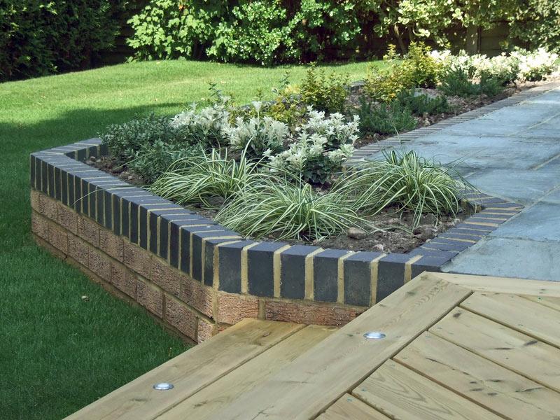 Raised brick planting bed with sleeper steps
