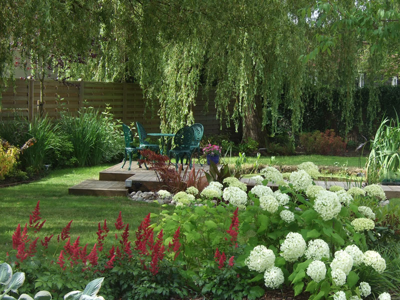 Large country garden with pond and decked seating area