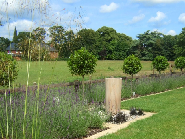 Large country garden with contemporary water feature and lavender