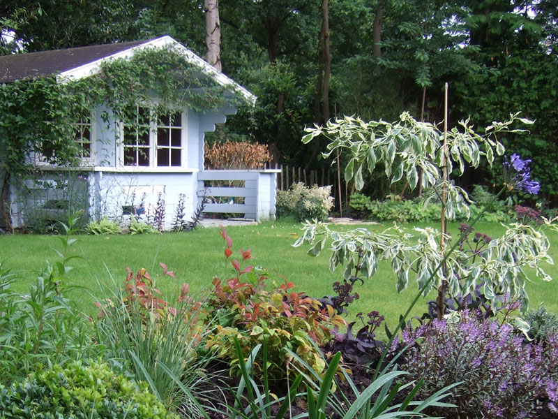 Traditional back garden with summerhouse