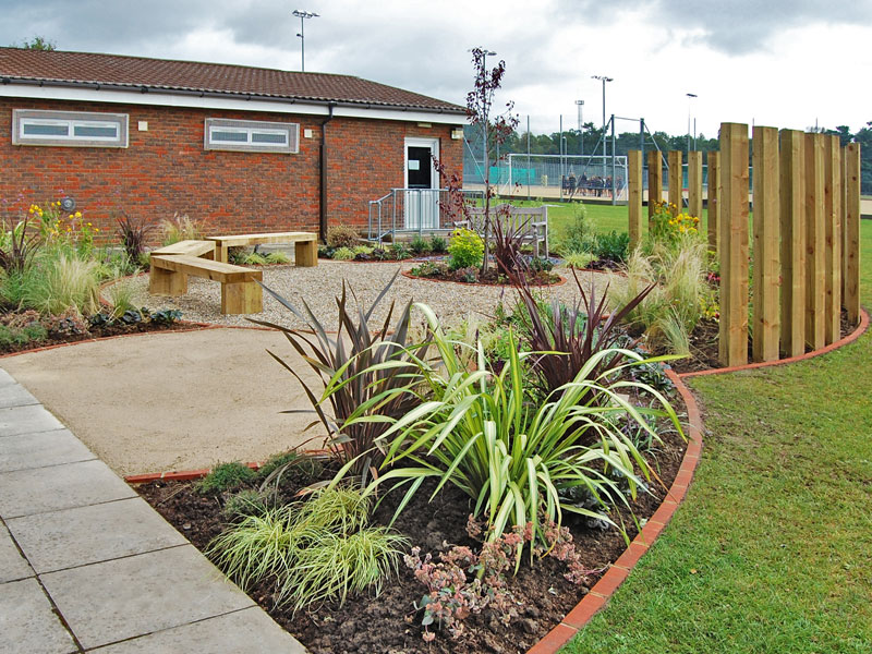 Memorial garden for school with upright sleeper screening and benches
