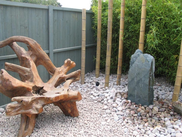 Pebbles and cobbles with slate monolith and bamboo
