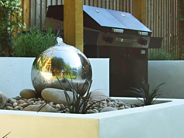 Stainless Steel Sphere Water Feature with Ophiopogon nigrescens