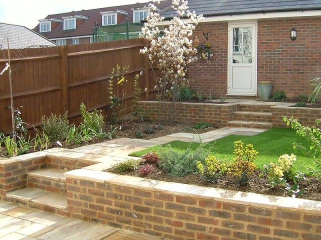 Terraced garden with sandstone paths and brick retaining walls