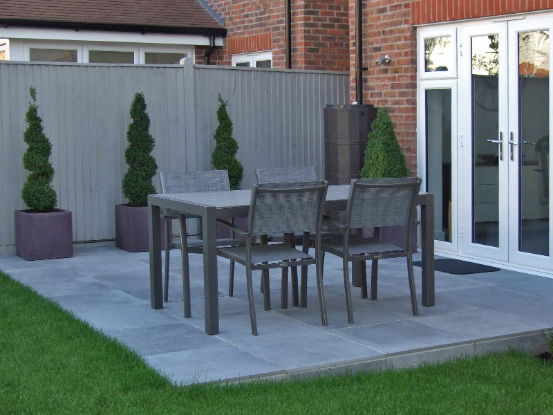 Porcelain paved dining area with topiary box spirals