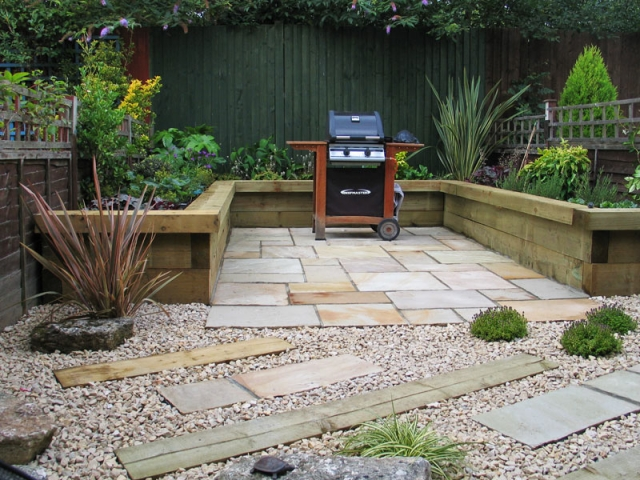 Compact garden - View to back with paved BBQ area and raised beds