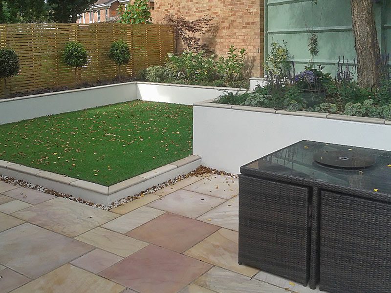Contemporay garden with different levels and artificial grass