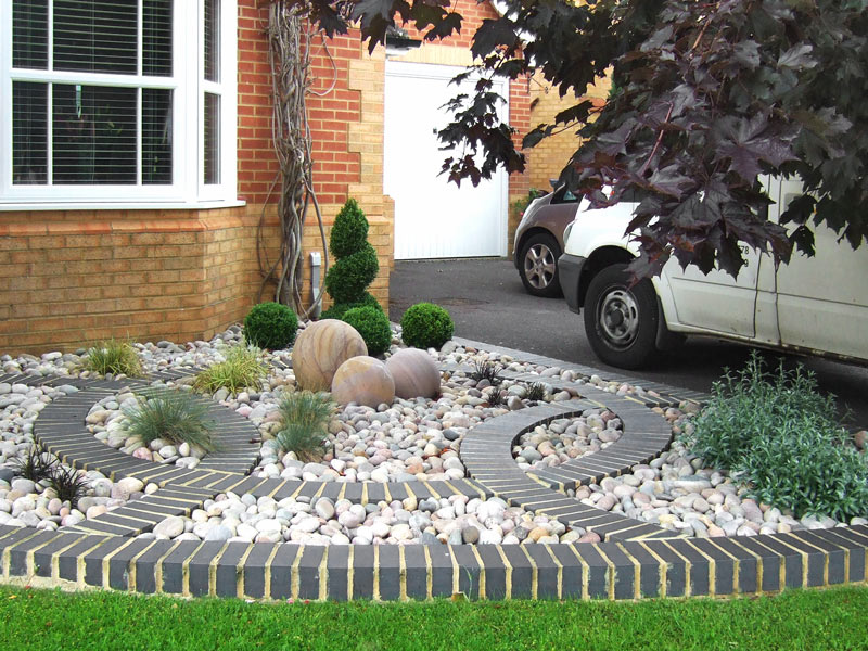 Front Garden with curving brick motif and cobbl
