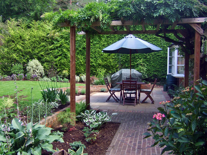 Traditional garden with pergola and sunken patio