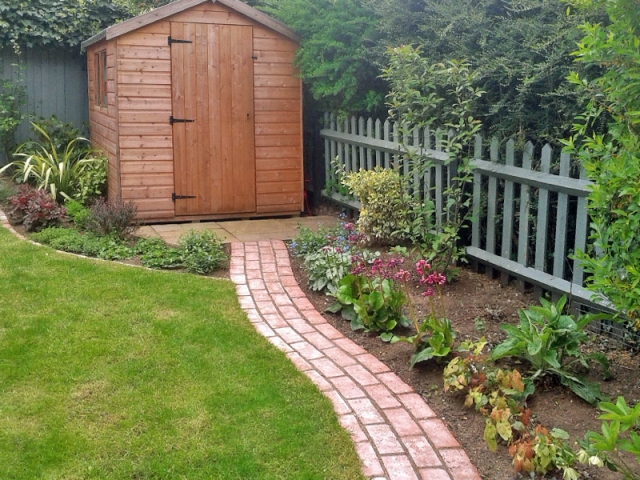 Simple running brick path to shed