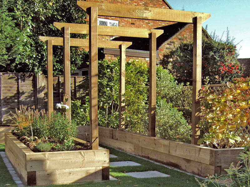 Timber arches between sleeper raised beds