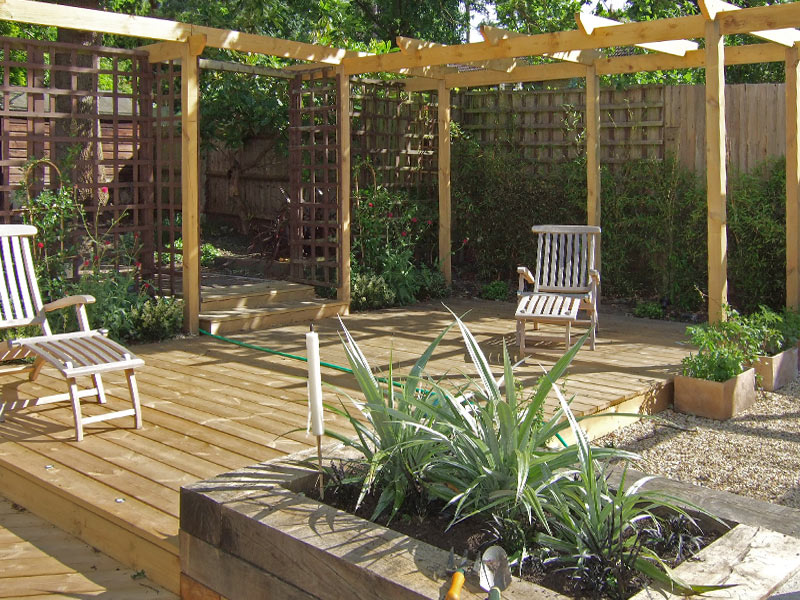 Pergola, deck and sleeper raised beds