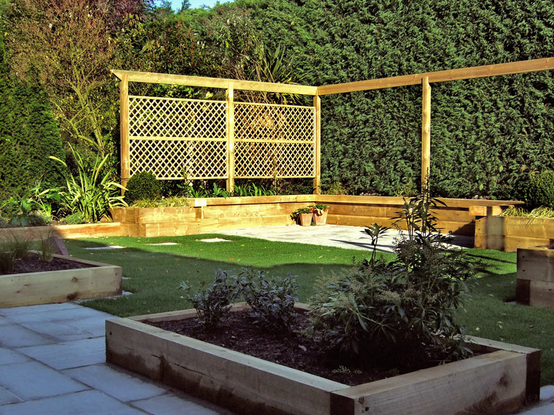 Arbour rail with trellis panels and sleeper raised beds