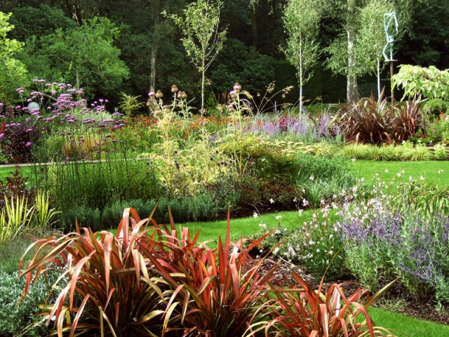 Large mixed borders with bold swathes of colour