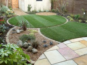 Small garden with circular lawn and seating areas