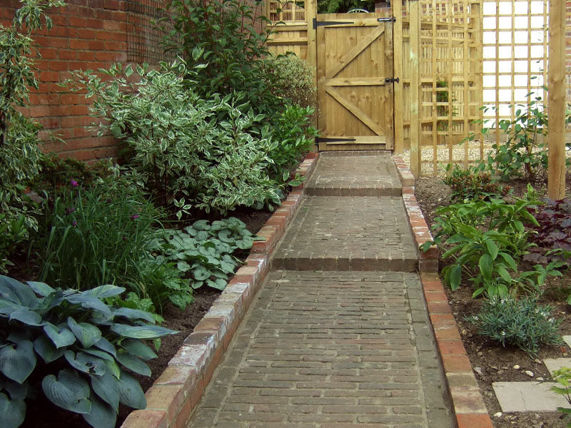 Traditional garden with original brick path to cottage