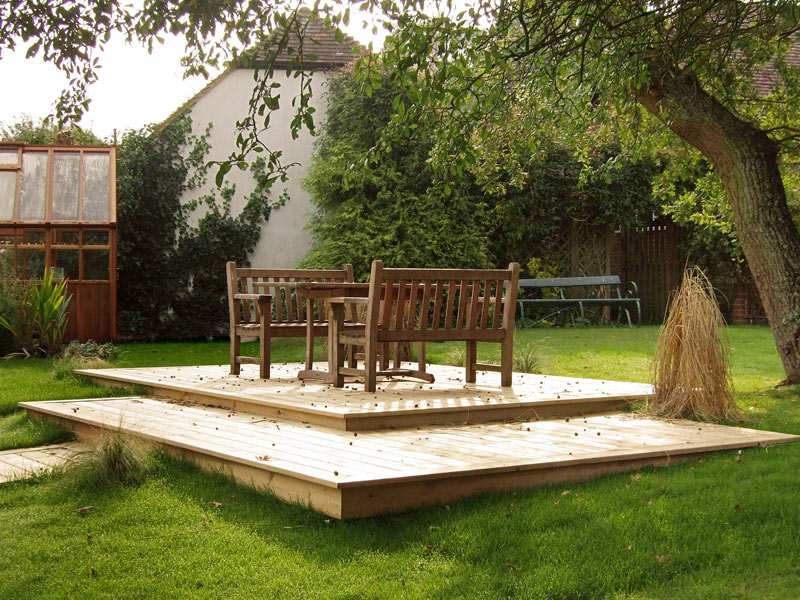 Split level decking under an old apple tree