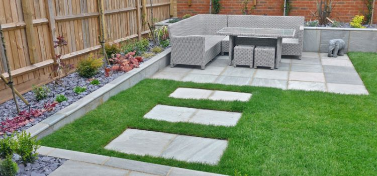 Stylish, Low Maintance Garden Featuring Grey Sandstone Planters