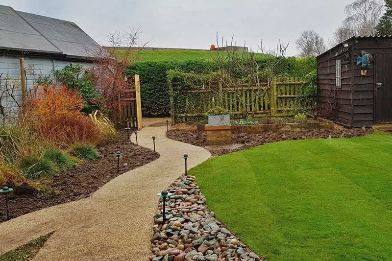 Resin path across garden provides improved access to the house boat
